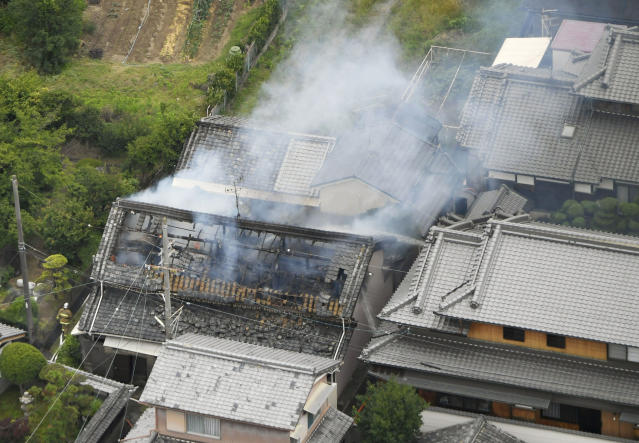 <p>Smoke rises from a house blaze in Takatsuki, Osaka, following an earthquake Monday, June 18, 2018. (Photo: Kyodo News via AP) </p>