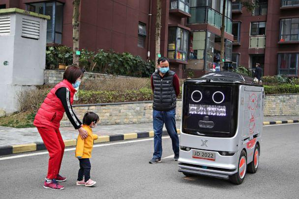 PHOTO: The intelligent distribution robot is sending packages 'contactlessly' during the COVID-19 outbreak in Guiyang, Guizhou, China on Feb. 26, 2020. (PG via ZUMA Press)
