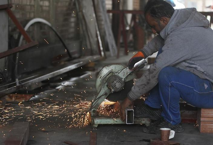 A worker welds iron on a construction site in the Iraqi capital Baghdad as lawmakers approved the government's 2019 budget, which at $111.8 billion is one of the largest ever for the oil-rich country (AFP Photo/AHMAD AL-RUBAYE)