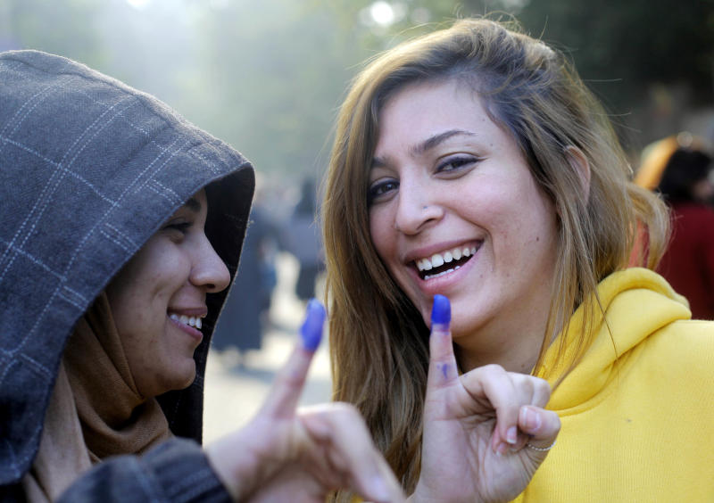 FILE - In this Saturday, Dec. 15, 2012 file photo, Egyptians girls show their inked fingers after casting their votes at a polling station in a referendum on a disputed constitution drafted by Islamist supporters of President Mohammed Morsi in Cairo, Egypt. Barely a third of voters turned out for the referendum on a constitution meant to be a historic milestone in setting Egypt's future. Perhaps it was fatigue after multiple elections, or a frustrated shrug. (AP Photo/Amr Nabil, File)