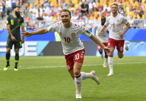 Denmark's Christian Eriksen celebrates after scoring the opening goal during the group C match between Denmark and Australia at the 2018 soccer World Cup in the Samara Arena in Samara, Russia, Thursday, June 21, 2018. (AP Photo/Martin Meissner)