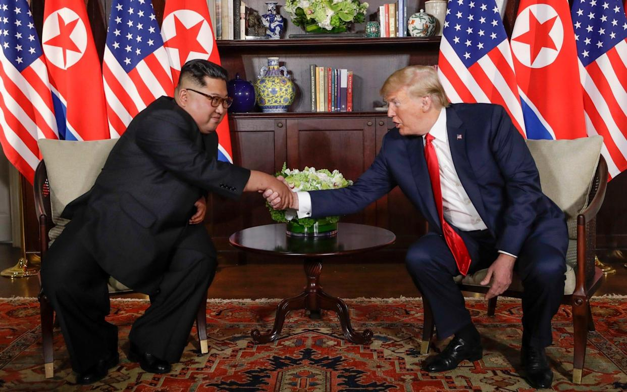 The two leaders during their meeting in Singapore - AP