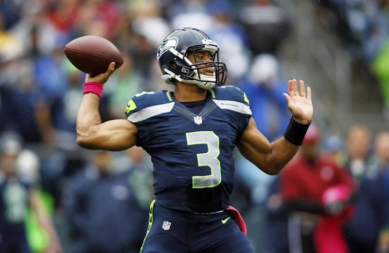 Seattle Seahawks quarterback Russell Wilson throws in the first half of an NFL football game against the New England Patriots, Sunday, Oct. 14, 2012, in Seattle. (AP Photo/John Froschauer)
