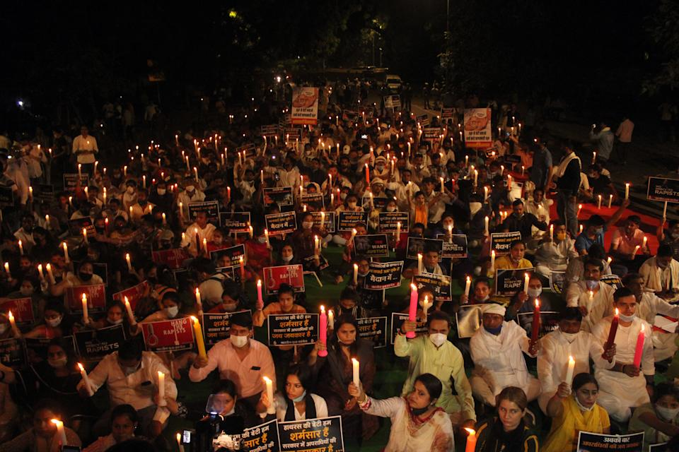 Activists of the Indian Youth Congress took out a candle light march at Jantar Mantar demanding justice for the Hathras gang-rape victim, who died at a government hospital in Delhi last month, on October 12, 2020 in New Delhi, India. The candle light march was also joined by Rajya Sabha MP Shaktisinh Gohil. (Photo by Mayank Makhija/NurPhoto via Getty Images)