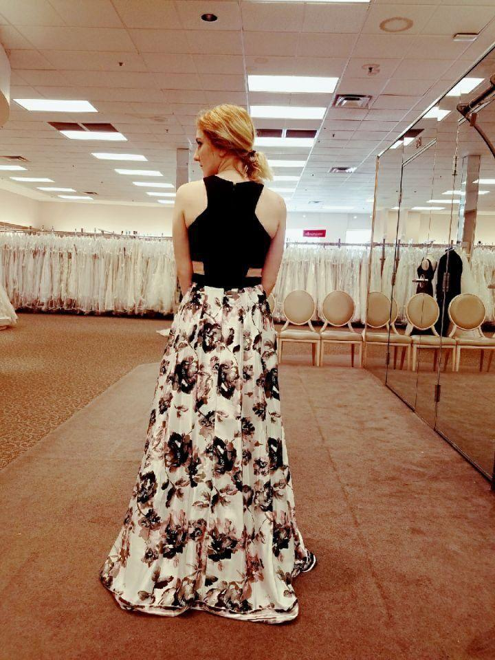 This is Josie's dress from the back, she was going for a conservative look while shopping for it.