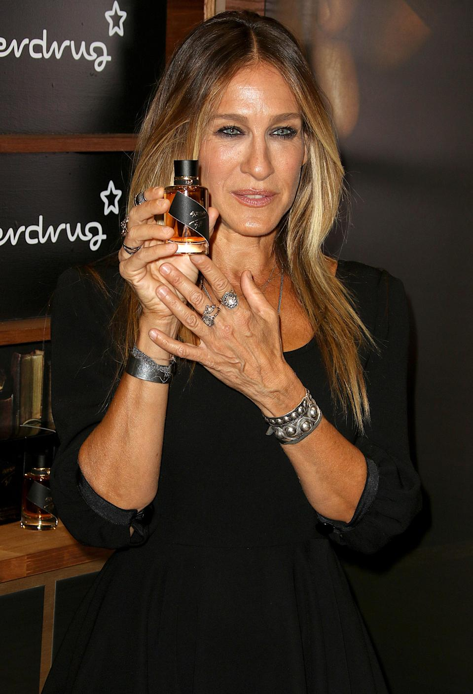 """<p>SJP released her first fragrance, Lovely, in 2005 following it up with five more: Covet, Covet Pure Bloom, Dawn, Endless and Twilight. In 2009, she launched yet another, calling it NYC. A year later, it was revealed that the new perfume had netted the 'Sex and the City' star <a href=""""https://www.popsugar.com/celebrity/Angelina-Jolie-Sarah-Jessica-Parker-Top-Paid-Actresses-30-Million-18174427"""" rel=""""nofollow noopener"""" target=""""_blank"""" data-ylk=""""slk:£13.5 million"""" class=""""link rapid-noclick-resp"""">£13.5 million</a>.<br><i>[Photo: Getty]</i> </p>"""