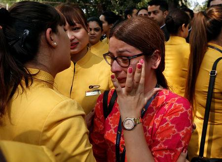 """An employee of Jet Airways is consoled by her colleagues during a protest demanding to """"save Jet Airways"""" in New Delhi, India, April 18, 2019. REUTERS/Adnan Abidi"""