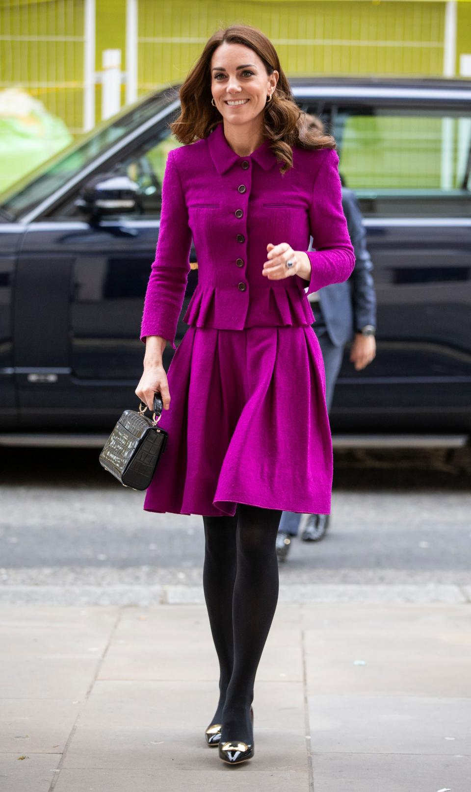 For a trip to the Royal Opera House, the Duchess of Cambridge recylced a £2,700 Oscar de la Renta skirt suit which she was first photographed wearing back in February 2017. To finish the high fashion ensemble, the 37-year-old wore £525 Rupert Sanderson block heels with winter-ready tights and a £495 Aspinal of London bag. [Photo: Getty]