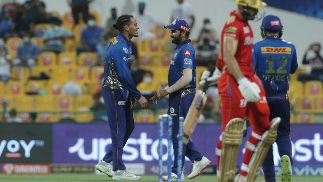 Rahul Chahar of Mumbai Indians and Rohit Sharma captain of Mumbai Indians celebrates the wicket of Aiden Markram of Punjab Kings during match 42 of the Vivo Indian Premier League between the Mumbai Indians and the Punjab Kings held at the Sheikh Zayed Stadium, Abu Dhabi in the United Arab Emirates on the 28th September 2021 Photo by Vipin Pawar / Sportzpics for IPL