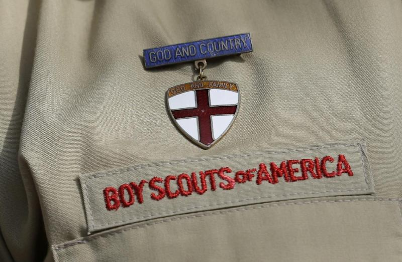This photo taken Monday, Feb. 4, 2013, shows a close up detail of a Boy Scout uniform worn by Brad Hankins, a campaign director for Scouts for Equality, as he responds questions during a news conference in front of the Boy Scouts of America headquarters in Irving, Texas. The Boy Scouts of America's policy excluding gay members and leaders could be up for a vote as soon as Wednesday, when the organization's national executive board meets behind closed doors under intense pressure from several sides. (AP Photo/Tony Gutierrez)