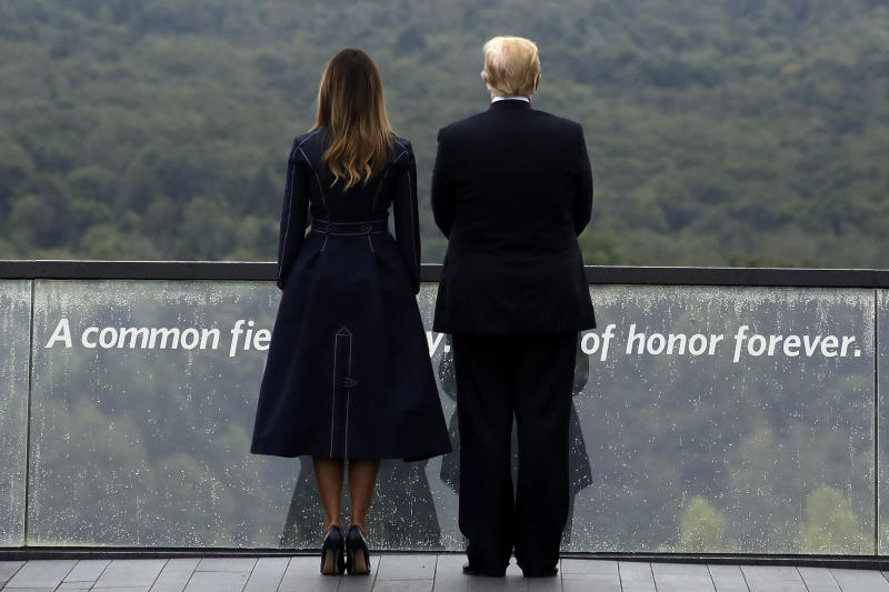 President Donald Trump and first lady Melania Trump, stand along the September 11th Flight 93 Memorial, Tuesday, Sept. 11, 2018, in Shanksville, Pa., escorted by (AP Photo/Evan Vucci)