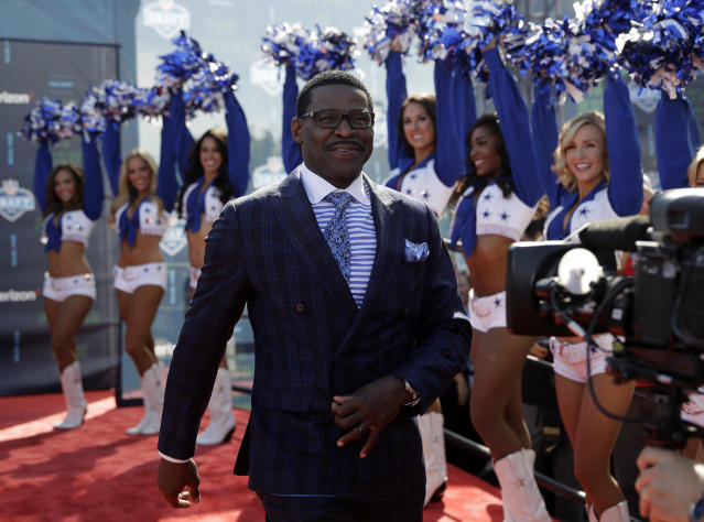 <p>Broadcast analyst and Hall of Famer Michael Irvin walks the red carpet before the first round of the 2018 NFL football draft, Thursday, April 26, 2018, in Arlington, Texas. (AP Photo/Eric Gay) </p>