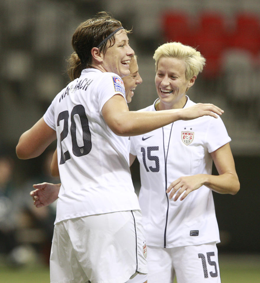 VANCOUVER, CANADA - JANUARY 22:  Abby Wambach #20 and Mega Rapinoe #15 of the United States celebrate a goal against Guatemala during the 2012 CONCACAF Women's Olympic Qualifying Tournament at BC Place on January 22, 2012 in Vancouver, British Columbia, Canada.  (Photo by Jeff Vinnick/Getty Images)