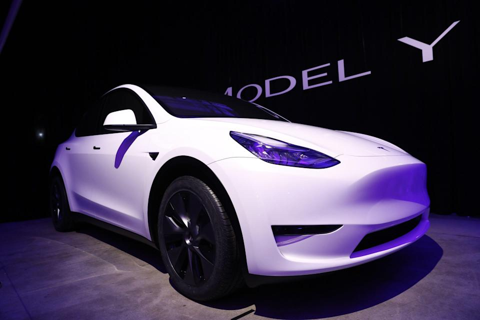 The Tesla Inc. Model Y crossover electric vehicle sits on display during an unveiling event in Hawthorne, California, U.S., on Friday, March 15, 2019. Tesla Chief Executive Officer Elon Musk said the cheaper electric crossover sports utility vehicle (SUV) will be available from the spring of 2021. The vehicle's price will start at $39,000, a longer-range version will cost $47,000. Photographer: Patrick T. Fallon/Bloomberg via Getty Images