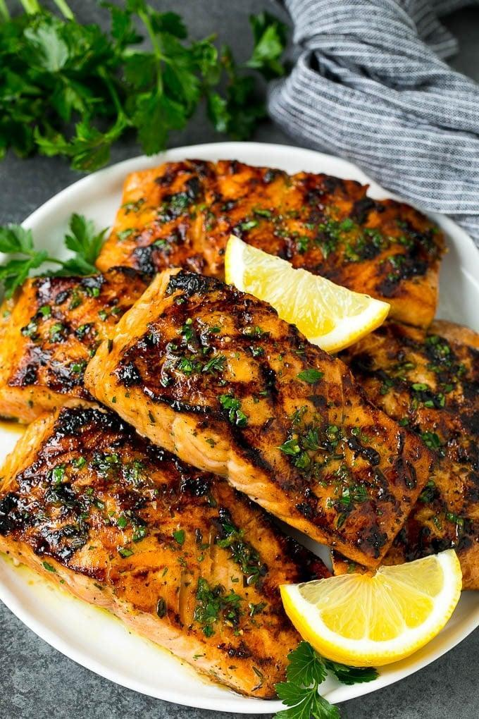 "<p>This foolproof grilling recipe for salmon is perfect for beginners.</p> <p><strong>Get the recipe:</strong> <a href=""https://www.dinneratthezoo.com/grilled-salmon/"" class=""link rapid-noclick-resp"" rel=""nofollow noopener"" target=""_blank"" data-ylk=""slk:grilled salmon with garlic and herbs"">grilled salmon with garlic and herbs</a></p>"