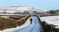 A cyclist makes their way through the snow at Blackmoss Reservoir in Barley, Pendle, Lancashire. Weather and travel warnings remain in place for icy conditions across much of England and Scotland after the widespread snowfall of recent days. (Photo by Peter Byrne/PA Images via Getty Images)