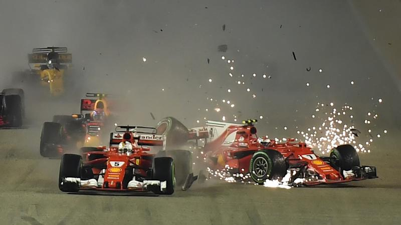 Both Ferraris crash out in wet Singapore