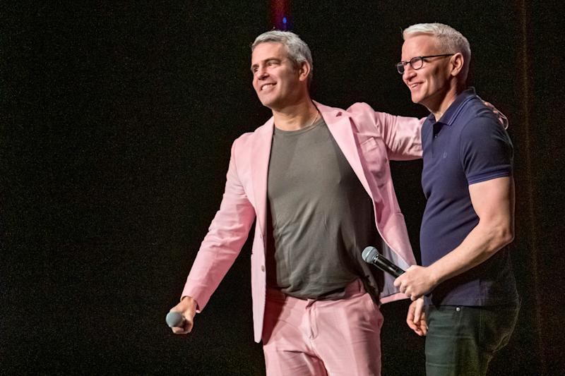 Andy Cohen, left, and Anderson Cooper participate in