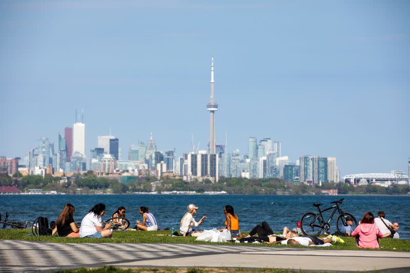 FILE PHOTO: People in Ontario maintain social distancing amid (COVID-19) restrictions in Toronto in May 2020