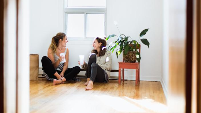 Two girls moving in a new house