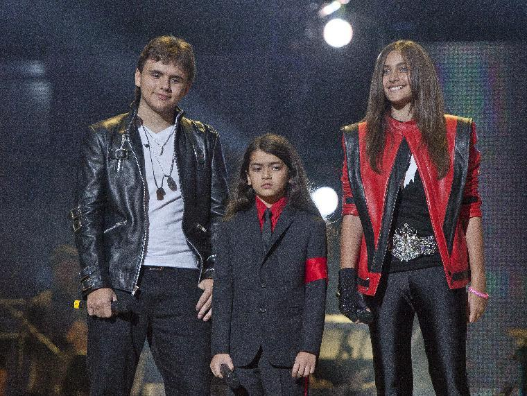 """FILE - In this Oct. 8, 2011 file photo, from left, Prince Jackson, Prince Michael II """"Blanket"""" Jackson and Paris Jackson arrive on stage at the Michael Forever the Tribute Concert, at the Millennium Stadium in Cardiff, Wales. TJ Jackson, one of Michael's favorite nephews, has been designated to work beside Michael's mother, Katherine, to look after the welfare of his three cousins Prince, 15, Paris, 14 and Blanket,10, who will inherit the King of Pop's fortune. (AP Photo/Joel Ryan, File) *Editorial Use Only*"""