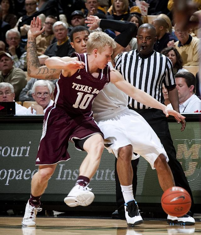 Texas A&M's Blake McDonald (10) gets tangled up with Missouri's Jabari Brown as they vie for a loose ball during the first half of an NCAA college basketball game Wednesday, March 5, 2014, in Columbia, Mo. (AP Photo/L.G. Patterson)
