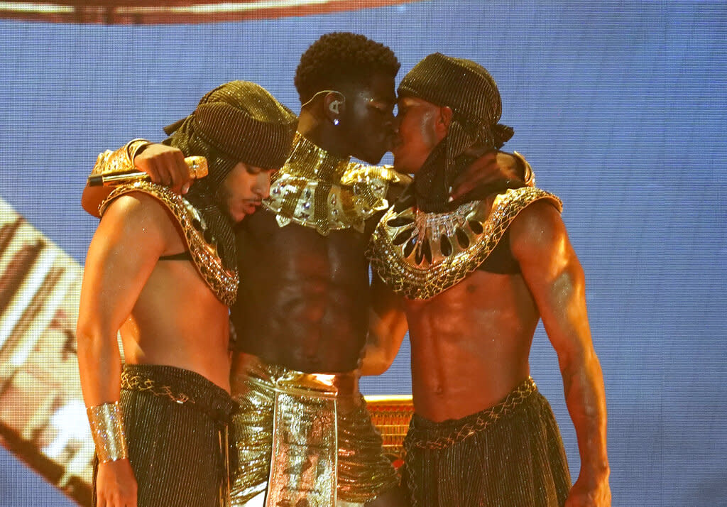 Lil Nas X kisses a dancer at the end of his performance at the BET Awards in Los Angeles. (Credit: AP Photo/Chris Pizzello)
