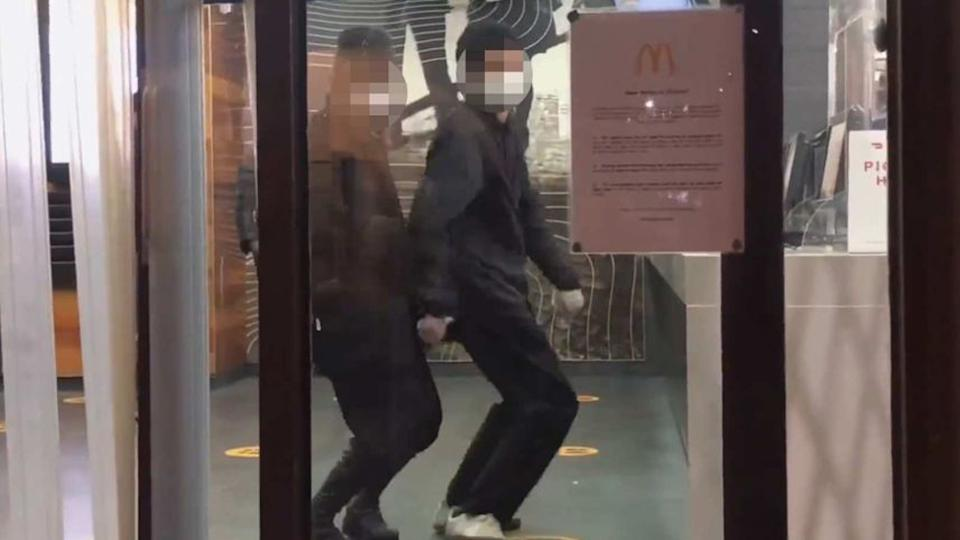 The group dance at the McDonald's entrance while breaching coronavirus curfew restrictions in Melbourne.