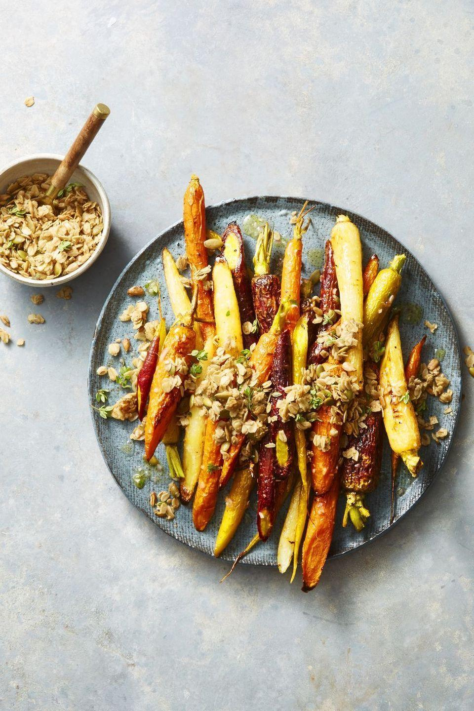 """<p>Carrots don't need butter to be delicious. This crunchy, nutty, granola-topped recipe is so good, it may even overshadow the main course.</p><p><em><a href=""""https://www.goodhousekeeping.com/food-recipes/easy/a22750582/roasted-carrots-with-cumin-thyme-granola-recipe/"""" rel=""""nofollow noopener"""" target=""""_blank"""" data-ylk=""""slk:Get the recipe for Roasted Carrots with Cumin-Thyme Granola »"""" class=""""link rapid-noclick-resp"""">Get the recipe for Roasted Carrots with Cumin-Thyme Granola »</a></em> </p>"""