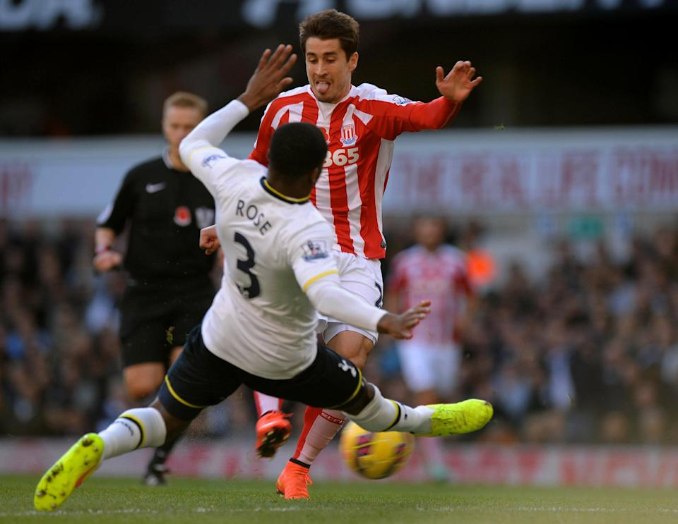 Stoke City's Spanish striker Bojan Krkic (R) fires his shot past the lunge of Tottenham Hotspur's English defender Danny Rose (L) to score the opening goal during the English Premier League football match on November 9, 2014 (AFP Photo/Olly Greenwood)