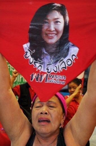 A supporter of Yingluck Shinawatra shouts slogans during a rally last year outside the Puea Thai headquarters in Bangkok. Thailand says it is boosting security ahead of an incendiary charter amendment case that could lead to the dissolution of the ruling party, with judges given special police protection