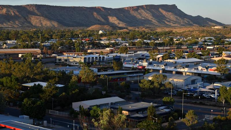 A woman is being treated in an Alice Springs hospital for dehydration and exposure after being lost