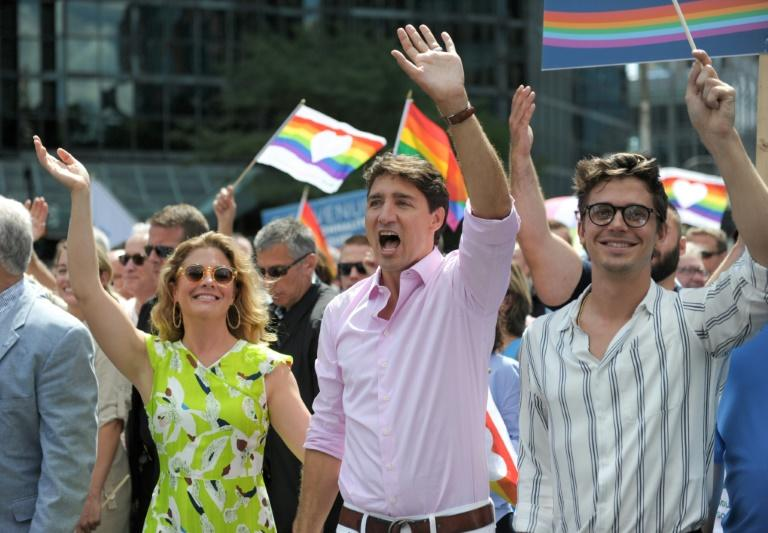 """It's great to celebrate today with everyone. Bonne fierte. Happy Pride,"" Justin Trudeau told the crowd, dressed in a pale pink shirt and white trousers"