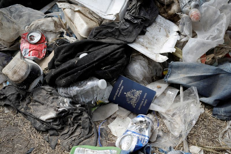 A Haitian passport is seen in a pile of trash near the International Bridge between Mexico and the U.S., where migrants seeking asylum in the U.S. are waiting to be processed, in Del Rio