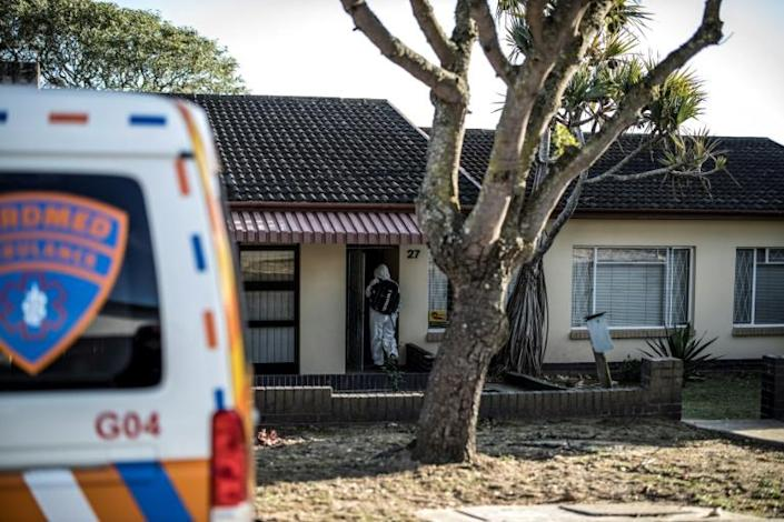 An ambulance crew answers a call from a patient with coronavirus. Hospitals in Port Elizabeth are so swamped that many patients are being treated just by paramedics (AFP Photo/MARCO LONGARI)