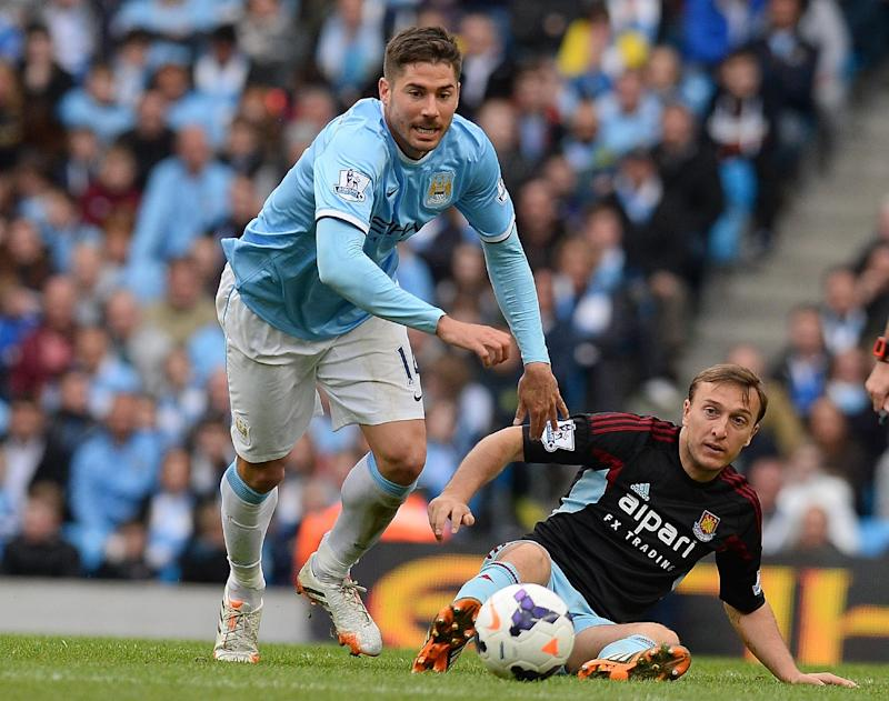 Manchester City's Spanish midfielder Javi Garcia (L) during the English Premier League football match between Manchester City and West Ham United at the Etihad Stadium on May 11, 2014