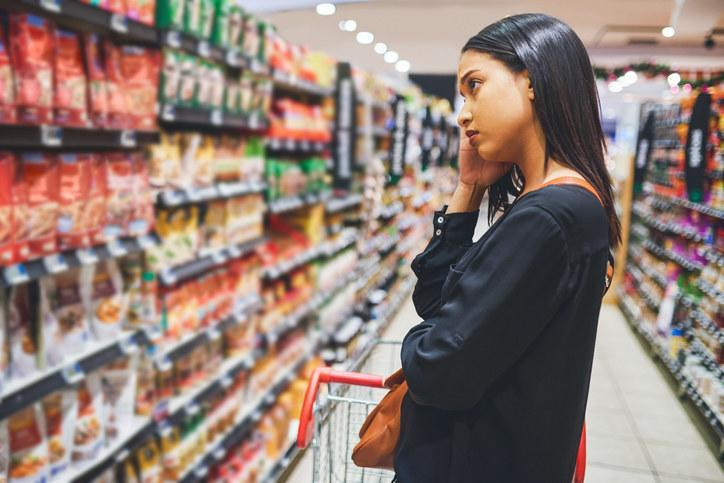 A woman looking at items in a grocery store