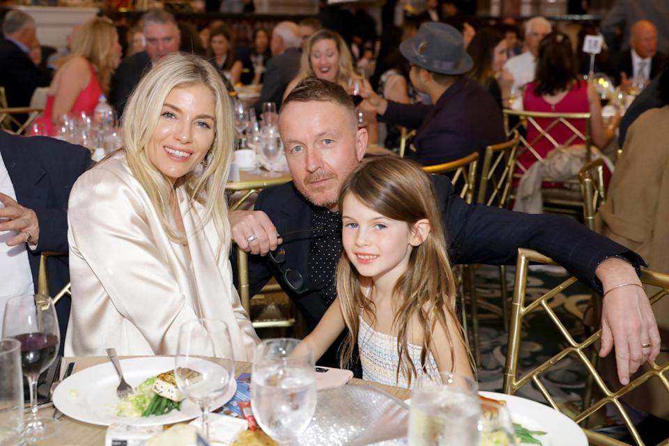 Sienna Miller, Jake Scott and Sienna's daughter Marlowe Ottoline Layng Sturridge at the International Medical Corps Annual Awards Celebration at The Beverly Wilshire on November 07, 2019 in Beverly Hills, California