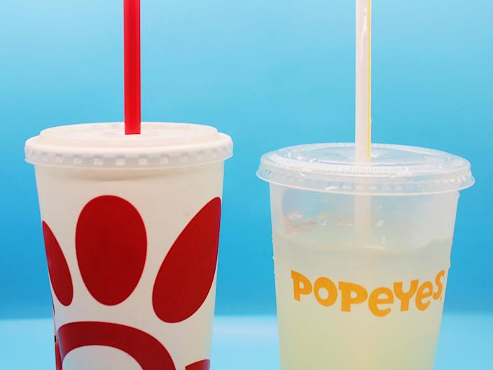 popeyes chick fil a lemonade cups on blue background