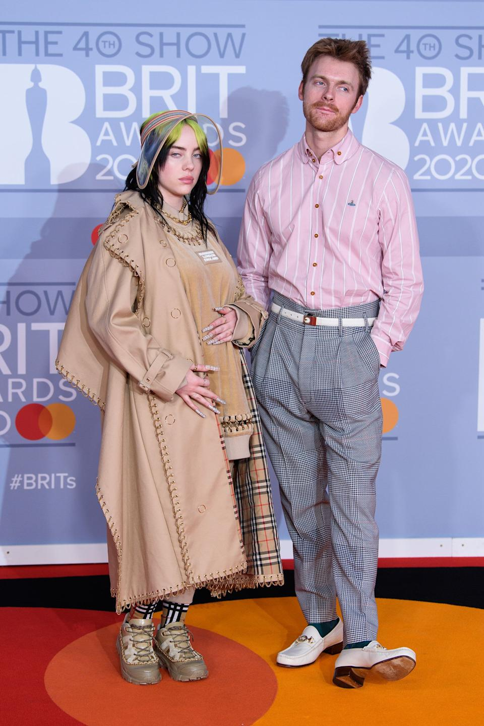 Lizzo and her brother, Finneas, at the Brit Awards (Photo: Joe Maher via Getty Images)