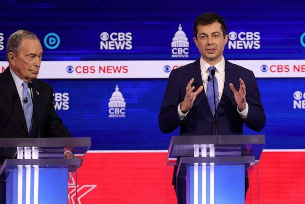 PHOTO: Democratic presidential candidate Pete Buttigieg speaks as former New York City Mayor Mike Bloomberg looks on during the Democratic presidential primary debate at the Charleston Gaillard Center, Feb. 25, 2020, in Charleston, South Carolina. (Win Mcnamee/Getty Images)