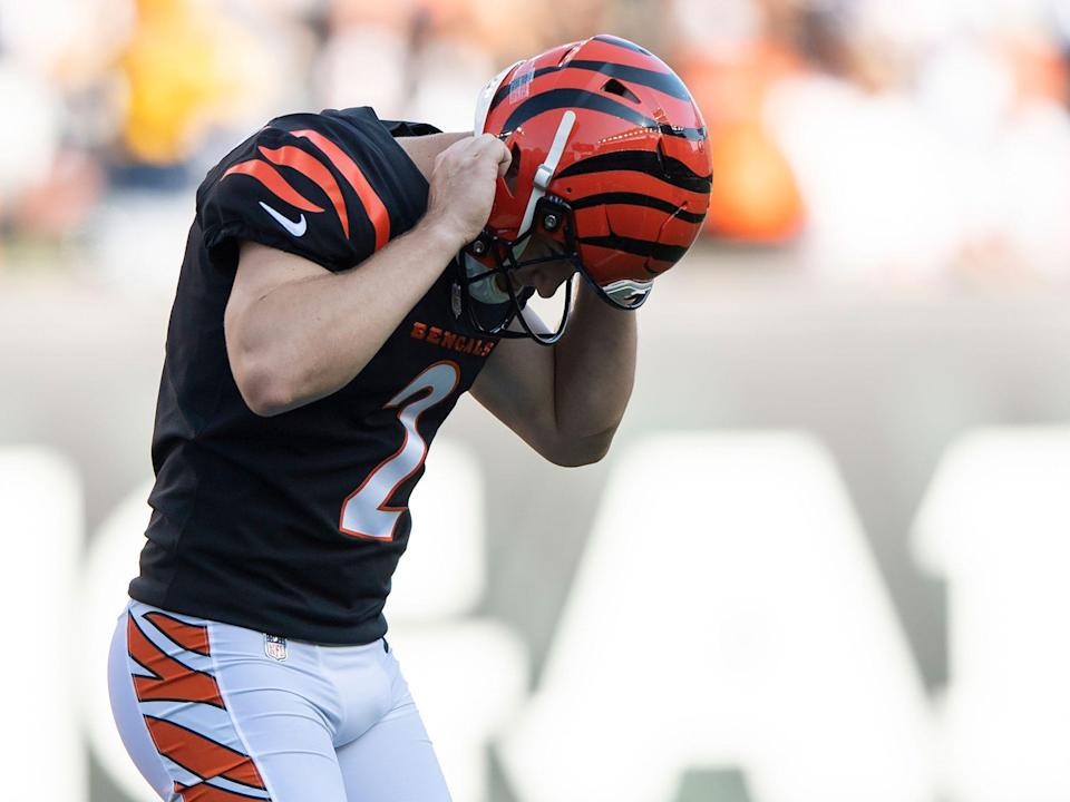 Evan McPherson reacts after missing a field goal against the Green Bay Packers.