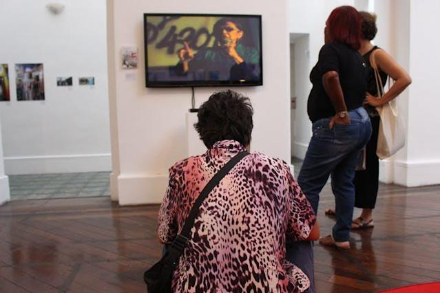 """<span class=""""caption"""">Visitors watching Laura Murray's documentary on Gabriela Leite, founder of the prostitution movement in Brazil.</span> <span class=""""attribution""""><span class=""""source"""">Amanda De Lisio, Bournemouth University</span></span>"""