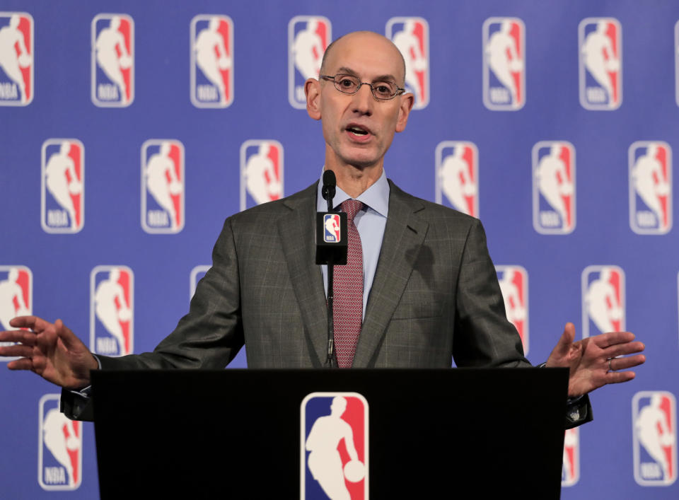 NBA commissioner Adam Silver's office reportedly issued a memo urging players to stand for the national anthem. (AP)