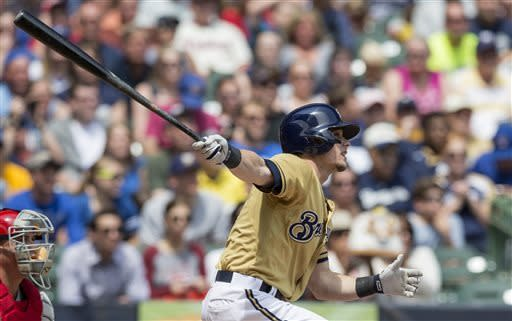 Milwaukee Brewers' Scooter Gennett connects for a two RBI triple during the second inning of a baseball game against the Philadelphia Phillies, Sunday, June 9, 2013, in Milwaukee. (AP Photo/Tom Lynn)