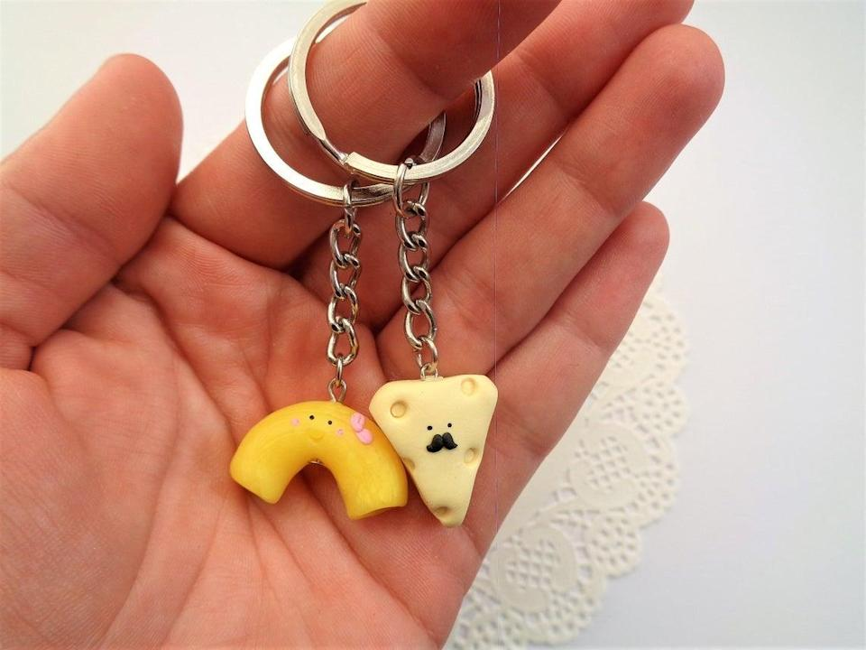 """<h2>Squirrel and Bunny Shop Mac and Cheese Keychain Set</h2><br>Is this person the cheese to your macaroni? Well, look no further than this perfectly paired keychain set. The only issue we foresee is deciding which food group to keep for yourself, and which one to give to your best bud. (We highly recommend checking out this seller's Etsy shop — there are many other food pairings to choose from, like milk and cookies, 'smores, and two halves of an avocado.)<br><br><em>Shop Squirrel and Bunny Shop on <strong><a href=""""https://www.etsy.com/shop/SquirrelandBunnyShop"""" rel=""""nofollow noopener"""" target=""""_blank"""" data-ylk=""""slk:Etsy"""" class=""""link rapid-noclick-resp"""">Etsy</a></strong></em><br><br><strong>Squirrel and Bunny Shop</strong> Mac and Cheese Keychain Set, $, available at <a href=""""https://go.skimresources.com/?id=30283X879131&url=https%3A%2F%2Fwww.etsy.com%2Flisting%2F690337353%2Fmac-and-cheese-keychain-valentines-day"""" rel=""""nofollow noopener"""" target=""""_blank"""" data-ylk=""""slk:Etsy"""" class=""""link rapid-noclick-resp"""">Etsy</a>"""
