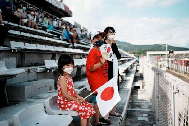 PHOTO: Limited numbers of fans watch in the Fuji International Speedway during the men's cycling road race at the 2020 Summer Olympics, Saturday, July 24, 2021, in Oyama, Japan. (Thibault Camus/AP Photo)