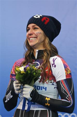 Noelle Pikus-Pace of the U.S. reacts after winning second place in the women's skeleton event at the 2014 Sochi Winter Olympics, at the Sanki Sliding Center in Rosa Khutor February 14, 2014. REUTERS/Murad Sezer