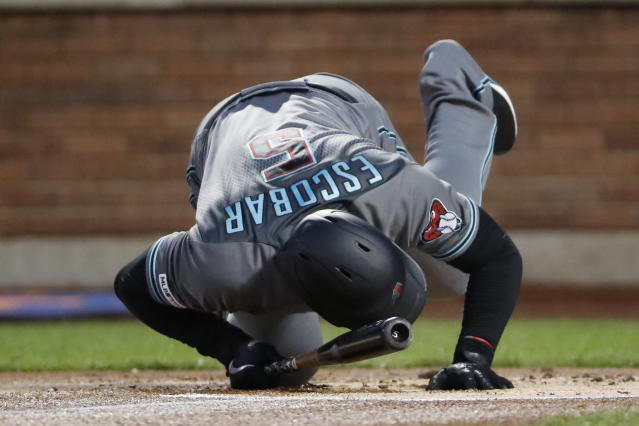 Arizona Diamondbacks' Eduardo Escobar dives to the dirt to avoid a pitch by New York Mets' Zack Wheeler during the first inning of a baseball game Tuesday, Sept. 10, 2019, in New York. (AP Photo/Kathy Willens)