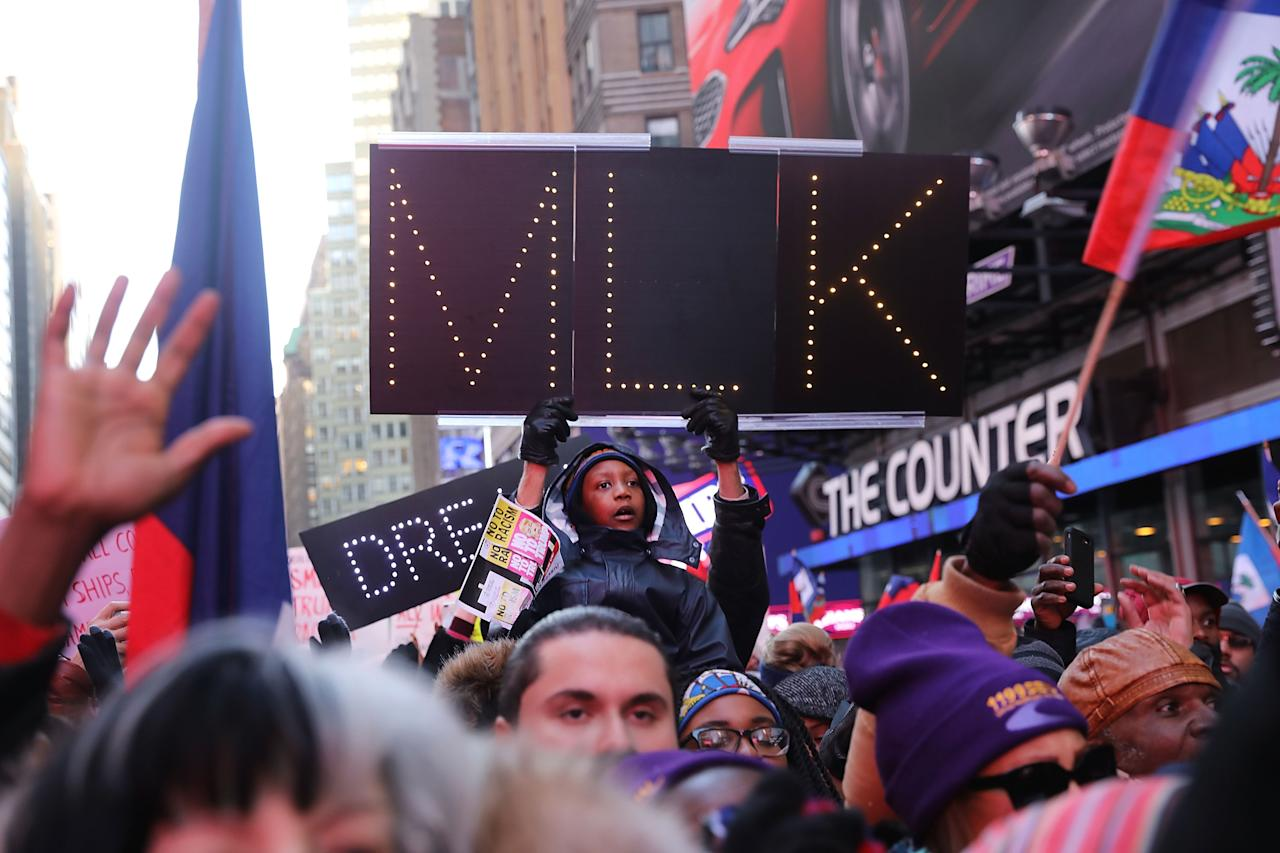 <p>Hundreds of people, many of them Haitian, demonstrate against racism in Times Square on Martin Luther King (MLK) Day on Jan. 15, 2018 in New York City. (Photo: Spencer Platt/Getty Images) </p>